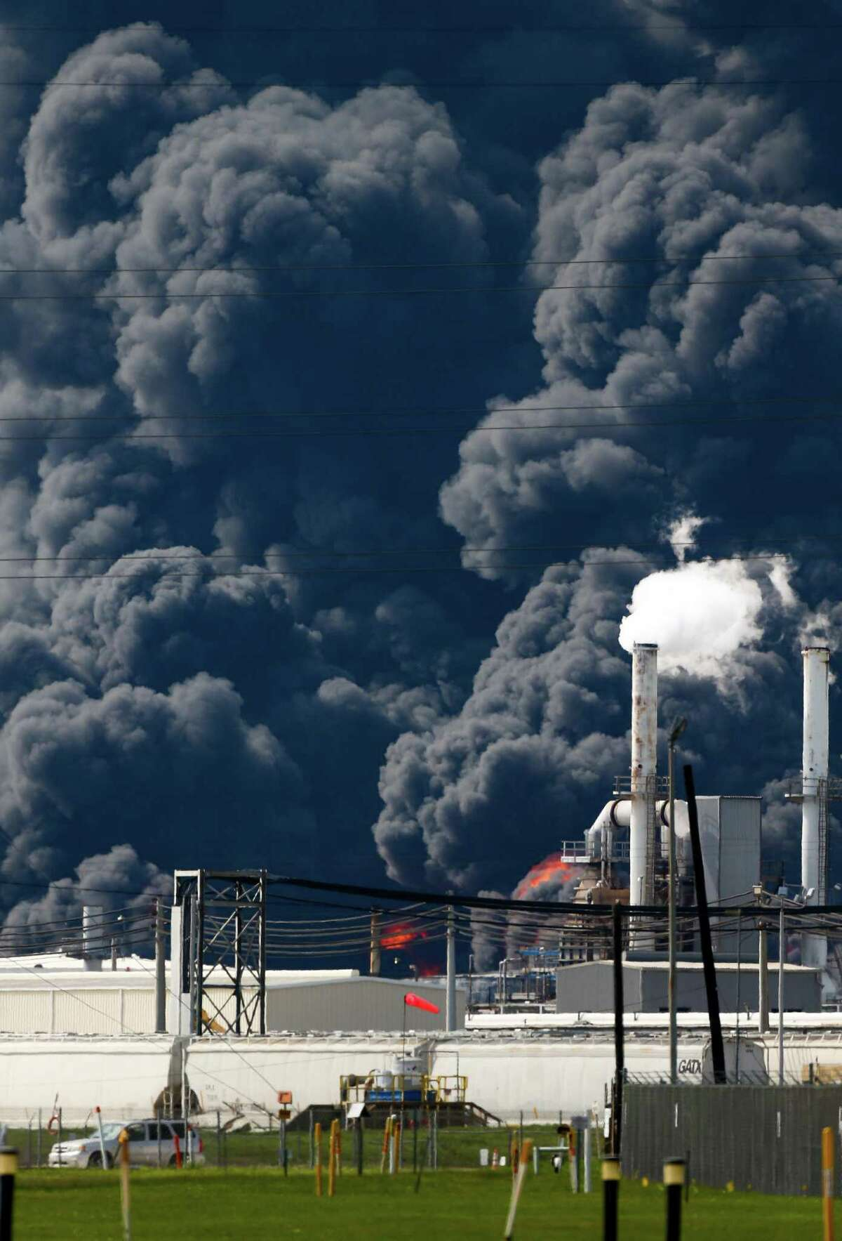 Firefighters battle the petrochemical fire at Intercontinental Terminals Company, which grew in size due to a lack of water pressure last night, Tuesday, March 19, 2019, in Deer Park, Texas.