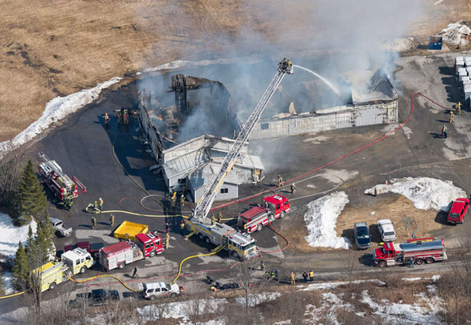 Firefighters from multiple departments extinguish a blaze that destroyed a garage and office at John VanWormer Septic Systems on Tuesday, March 19, 2019, on Deer Path Lane in Guilderland, N.Y. Photo: Aerial Photo By Daniel Spitzer / desmdpc