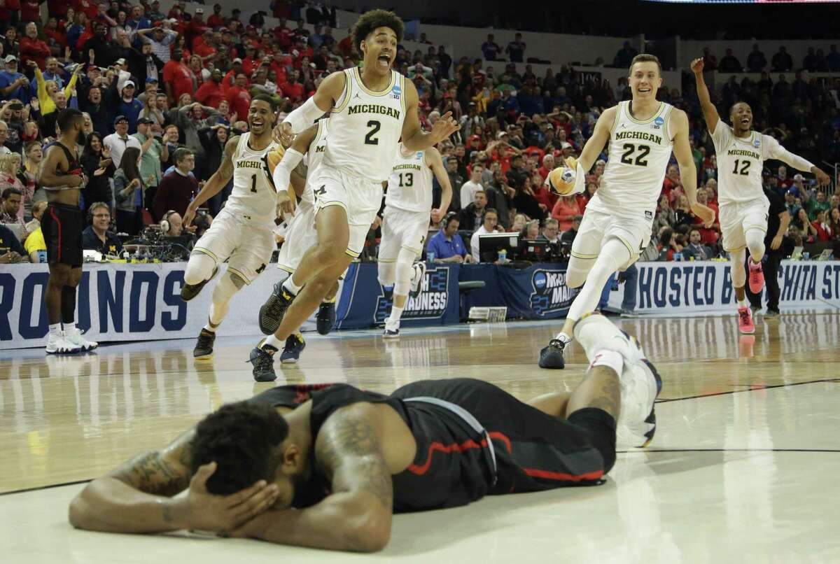 UH's Devin Davis hit the floor in disbelief after Jordan Poole (2) sank a 3-point buzzer beater to knock the Cougars out of the NCAA Tournament in last season's second round.