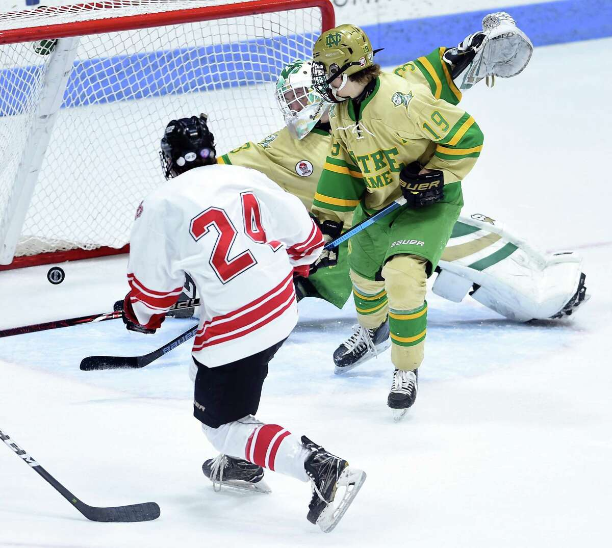 Fairfield Prep's Thomas Quinn, left, scores against Notre Dame-West Haven goalie Connor Smith in the first period of the CIAC Division I ice hockey final at Ingalls Rink in New Haven on Tuesday.