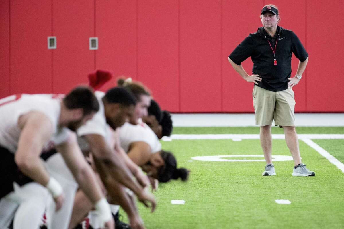University of Houston head coach Dana Holgorsen watches his player run through a workout during the first day of spring practice on Tuesday, March 19, 2019, in Houston.