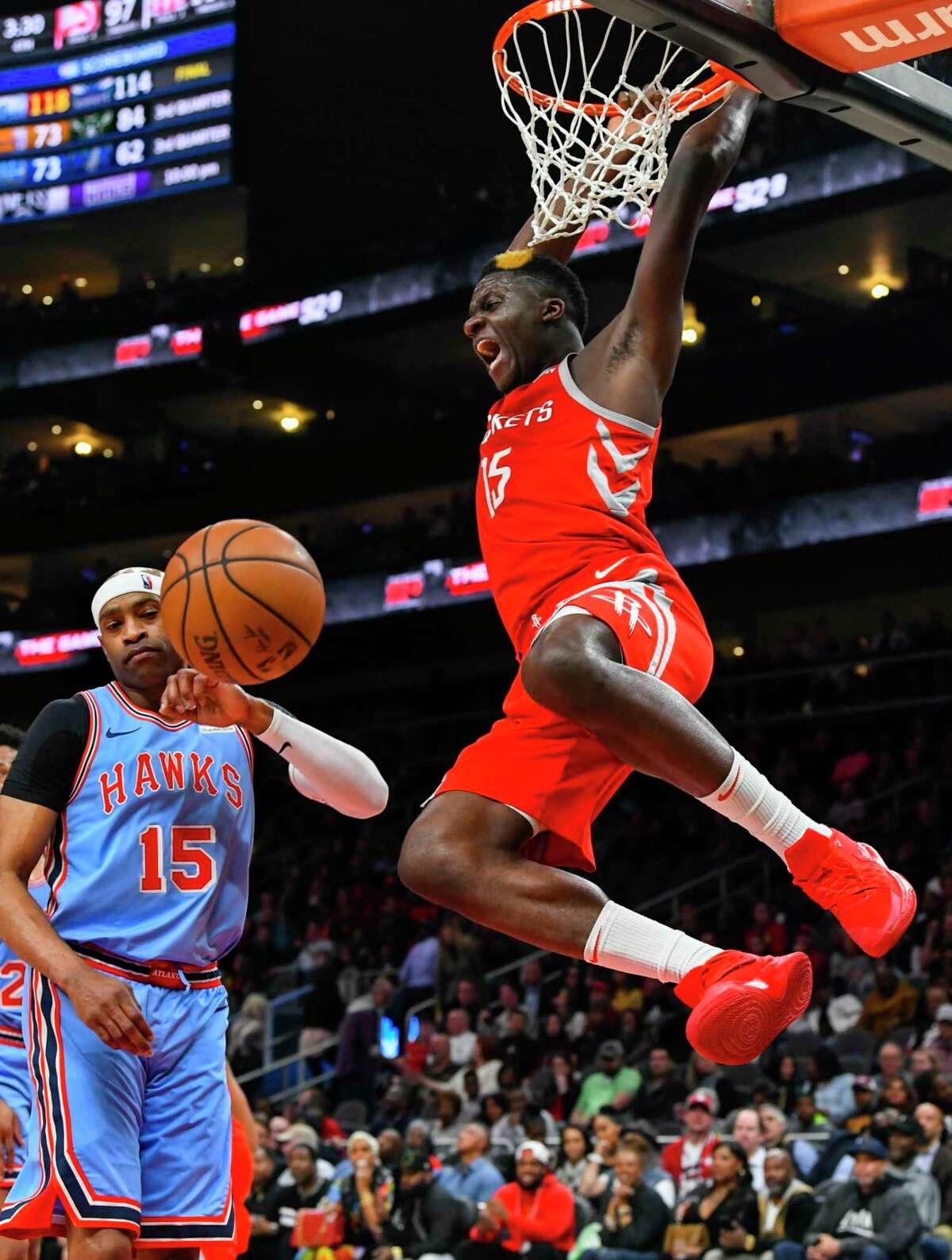 Houston Rockets center Clint Capela dunks on Atlanta Hawks forward Vince Carter, left, during the second half of an NBA basketball game Tuesday, March 19, 2019, in Atlanta. Houston won 121-105. (AP Photo/John Amis)