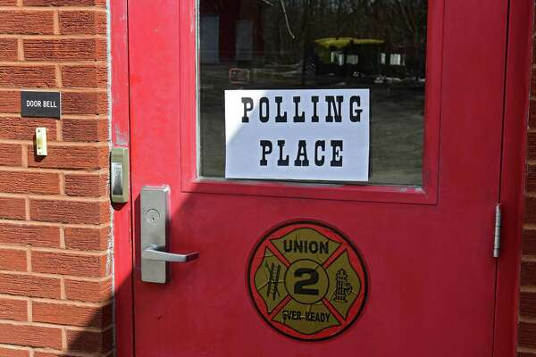 A polling sign is seen in the door of the Union Firehouse on a village election day Tuesday, March 19, 2019 in Ballston Spa, N.Y. Four trustees are competing for two seats. (Lori Van Buren/Times Union)