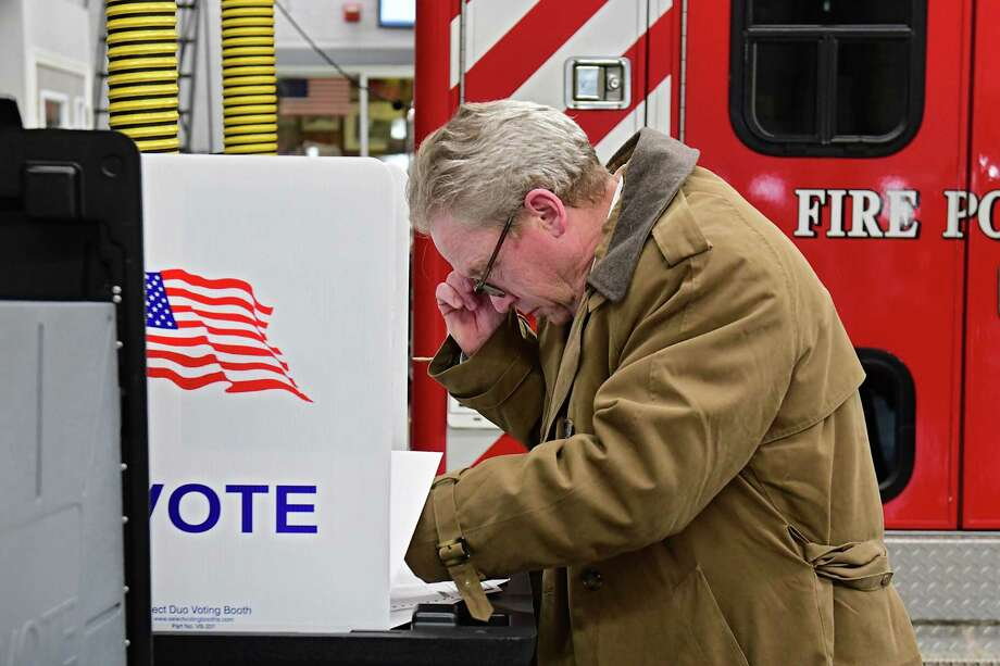 Ballston Spa resident Joseph Hogan fills out an election ballot at the Union Firehouse on a village election day Tuesday, March 19, 2019 in Ballston Spa, N.Y. Four trustees are competing for two seats. (Lori Van Buren/Times Union) Photo: Lori Van Buren / 40046448A