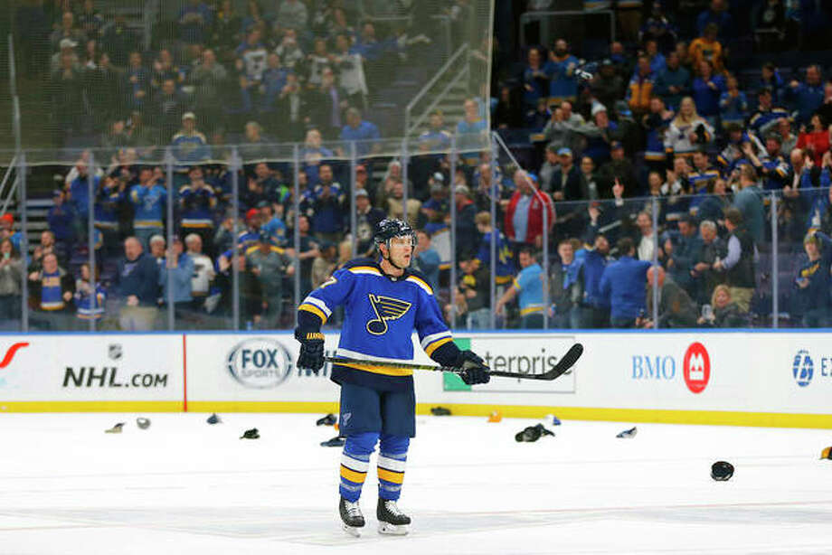 Fans throw their hats on the ice after the Blues' Jaden Schwartz (17) completed a hat trick against the Edmonton Oilers Tuesday in St. Louis. Photo: AP Photo