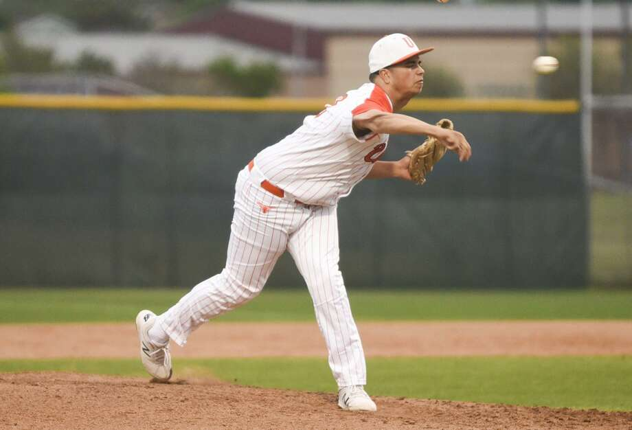 Adrian Castillo threw a two-hit complete game as the Longhorns won 9-1 over LBJ to remain tied for first in District 29-6A at 3-0. Photo: Danny Zaragoza /Laredo Morning Times