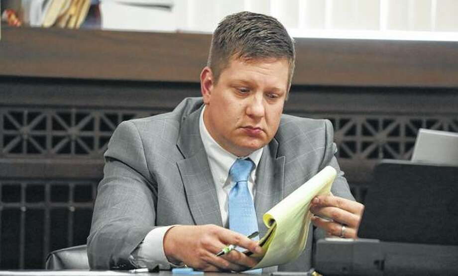 Then-Chicago police Officer Jason Van Dyke listens in September during during his first-degree murder trial for the shooting death of Laquan McDonald. The Illinois Supreme Court on Tuesday let stand a prison sentence of less than seven years for Van Dyke. Photo: Antonio Perez | Chicago Tribune Via AP, Pool