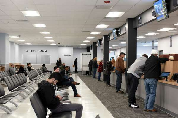 Customers are seen at the new Albany Department of Motor Vehicles office on Tuesday, March 19, 2019, at 855 Central Avenue in Albany, N.Y. The center was relocated from the South End. (Will Waldron/Times Union)