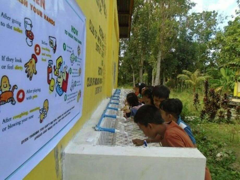 Midland Morning Rotary Club obtained a District Grant to partner with the Metro Passi Rotary Club, Philippines, in constructing handwashing facilities in two elementary schools. (Photo provided)