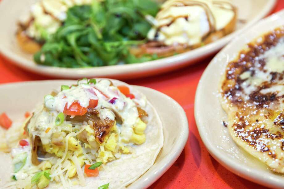 Snooze, an A.M. Eatery has opened its seventh Houston location in the Woodlands at 2415 Research Forest Dr. Shown: Huevos rancheros and pineapple upside down pancakes. Photo: Snooze