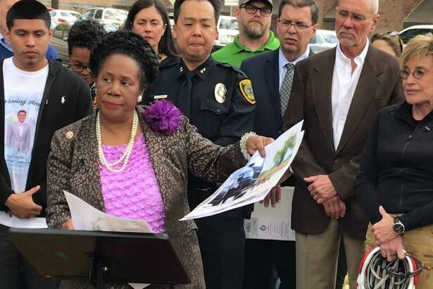 Rep. Sheila Jackson Lee, D-Houston, stands with the family of David Loya as she discusses the need for federal legislation to improve bicycle safety on streets on March 19, 2019, in Houston. Loya, 23, was killed March 7, 2019, while riding along Heights Boulevard.