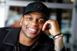 In this Jan. 22, 2019, photo, country singer Jimmie Allen poses in Nashville, Tenn. Allen is the first black artist to launch his career with a No. 1 single on the Billboard Country Airplay chart. (AP Photo/Mark Humphrey)