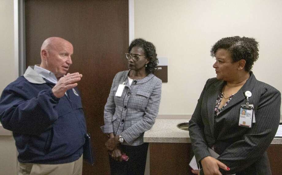 Congressman Kevin Brady, R-The Woodlands, left, speaks with nurse executive June Kelsick, center, and Dr. Cassandra Arceneaux, Houston VA Clinic director, during a tour of a dental clinic expansion Tuesday, March 19, 2019 at Conroe VA Outpatient Clinic in Conroe. Photo: Cody Bahn, Houston Chronicle / Staff Photographer / © 2018 Houston Chronicle
