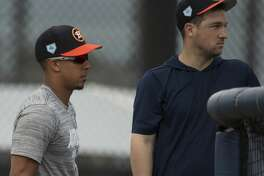 Houston Astros left fielder Michael Brantley, left, and third baseman Alex Bregman watch other left handed hitters practice at Fitteam Ballpark of The Palm Beaches on Day 1 of spring training on Thursday, Feb. 14, 2019, in West Palm Beach.
