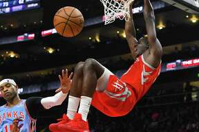 Houston Rockets center Clint Capela dunks in front of Atlanta Hawks forward Vince Carter, left, during the second half of an NBA basketball game Tuesday, March 19, in Atlanta. Houston won 121-105. (AP Photo/John Amis)