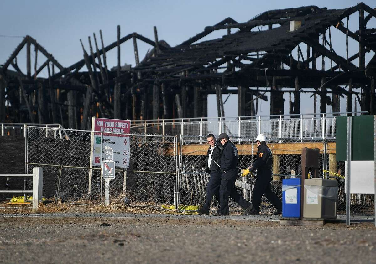 Fire investigators are on scene following a fire that destroyed the new pavilion, concessions, and bathrooms at Silver Sands State Park in Milford, Conn. on Wednesday, March 20, 2019. The fire started late Tuesday night and was fully involved when firefighters arrived on scene.
