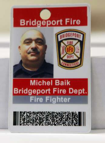 Bridgeport firefighter Michel Baik died while fighting a fire at 41 Elmwood Ave on Saturday, July 24, 2010. Lt. Steven Velasquez also died. They were found unconscious on the third floor of a three story home and transported to hospitals, where they were pronounced dead. Photo: B.K. Angeletti / Connecticut Post