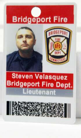 Bridgeport Lt. Steven Velasquez died while fighting a fire at 41 Elmwood Ave on Saturday, July 24, 2010. Michel Baik also died. They were found unconscious on the third floor of a three story home and transported to hospitals, where they were pronounced dead. Photo: B.K. Angeletti / Connecticut Post