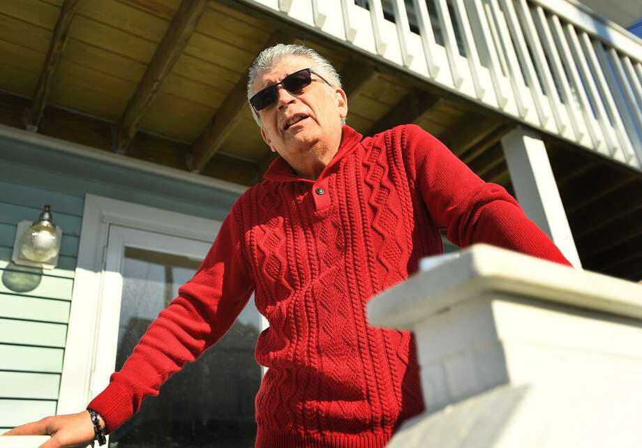 East Broadway resident Ray Meglio discusses the fire that destroyed the new pavilion, concessions, and bathrooms at Silver Sands State Park in Milford, Conn. on Wednesday, March 20, 2019. The fire started late Tuesday night and was fully involved when firefighters arrived on scene. Meglio said he had feared that embers from the fire might ignites nearby homes. Photo: Brian A. Pounds / Hearst Connecticut Media / Connecticut Post