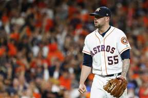 Houston Astros relief pitcher Ryan Pressly (55) strikes out Boston Red Sox Andrew Benintendi (16) to end the top of the seventh inning of Game 3 of the American League Championship Series at Minute Maid Park on Tuesday, Oct. 16, 2018, in Houston.