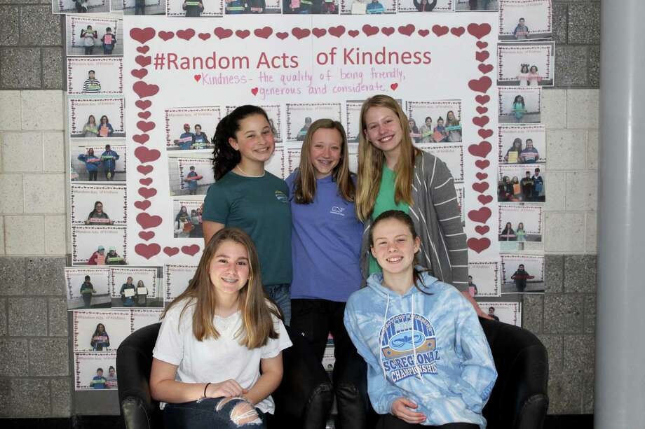 Old Saybrook Middle School was recognized recently by the Connecticut Association of Schools as the only institution in the state to be recognized for its positive school climate. From left are eighth-graders (front row) Juliette Condulis and Madelyn Beaudoin, and (back row) Alexandra LaMotte, Christina Grace and Laura Day. Photo: Contributed Photo