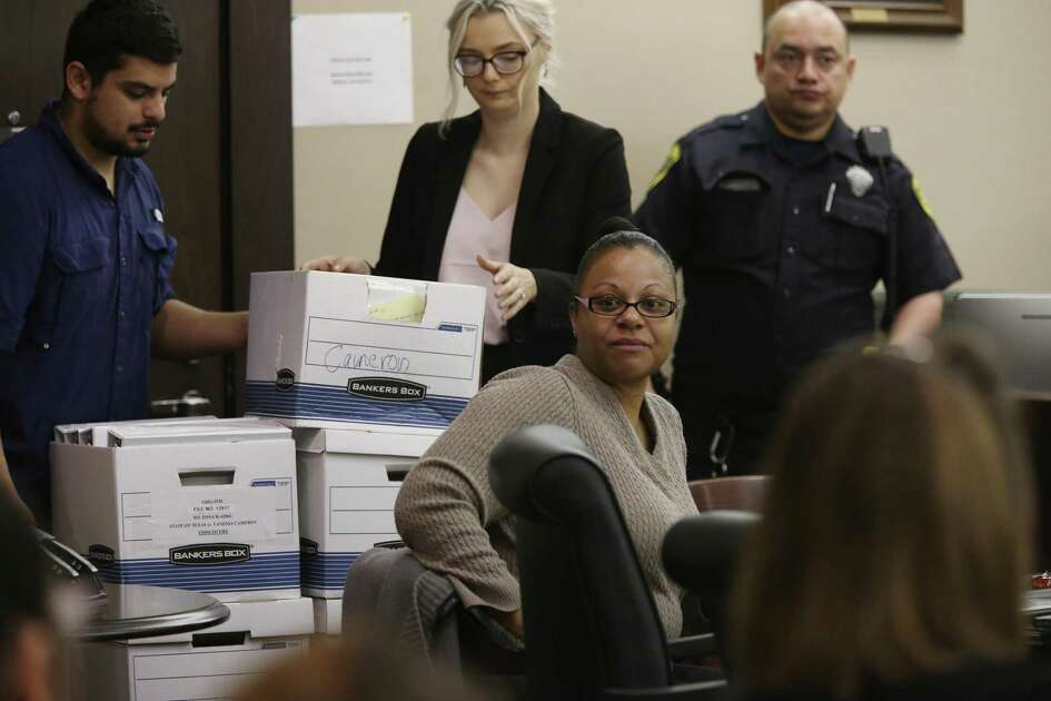Vanessa Cameron, seated center, looks around before the start of testimony in 226th District Court on March 12. Cameron was being re-tried on charges that she solicited the killing of her ex-boyfriend, Samuel Allen Johnson Jr., 26, in 2010. She was convicted again Tuesday and sentencing began Wednesday morning.
