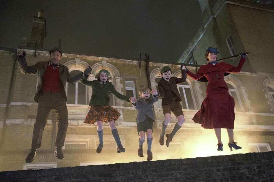 "This image released by Disney shows, from left, Lin-Manuel Miranda, Pixie Davies, Joel Dawson, Nathanael Saleh and Emily Blunt in ""Mary Poppins Returns."" Photo: Jay Maidment, HONS / Associated Press / © 2018 Disney Enterprises, Inc. All Rights Reserved."