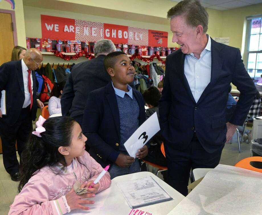 Governor Ned Lamont, left, tours Tracey Elementary School with the help of 5th grader Adrien Danso Wednesday January 16, 2019, prior to a roundtable discussion hosted by the Dalio Foundation at the school in Norwalk, Conn. The event highlighted the forthcoming release of a report from The Aspen Institute National Commission on Social, Emotional, and Academic Development titled, From a Nation at Risk to a Nation at Hope, which outlines steps officials should take to improve public education in the United States. Photo: Erik Trautmann / Hearst Connecticut Media / Norwalk Hour