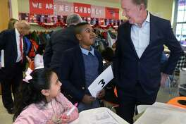 Governor Ned Lamont, left, tours Tracey Elementary School with the help of 5th grader Adrien Danso Wednesday January 16, 2019, prior to a roundtable discussion hosted by the Dalio Foundation at the school in Norwalk, Conn. The event highlighted the forthcoming release of a report from The Aspen Institute National Commission on Social, Emotional, and Academic Development titled, From a Nation at Risk to a Nation at Hope, which outlines steps officials should take to improve public education in the United States.