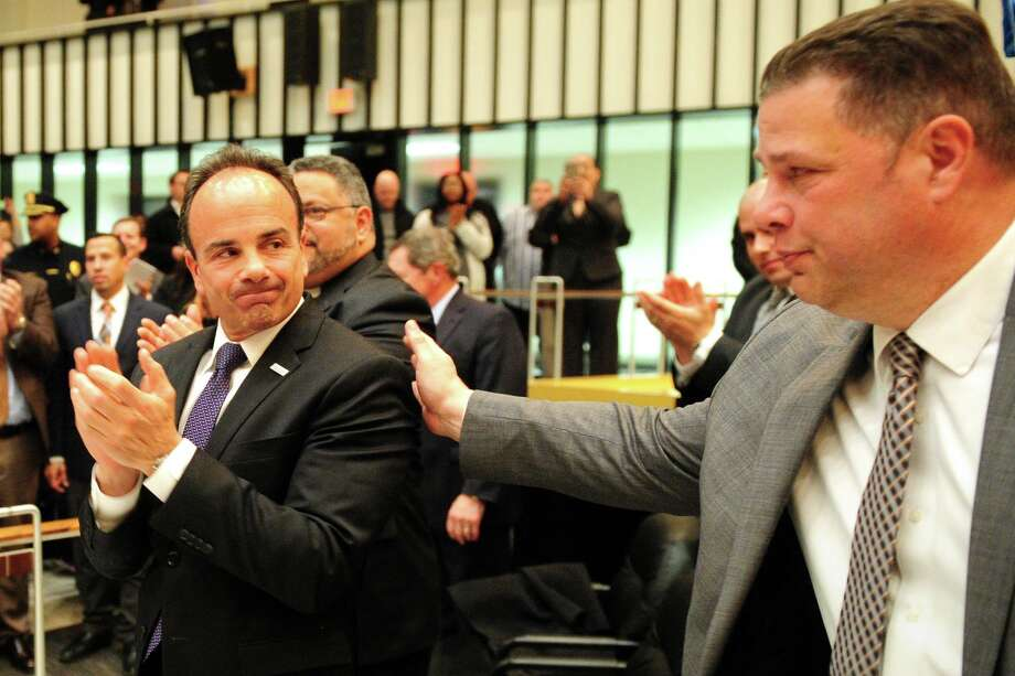 Mayor Joe Ganim and Bridgeport Police Department Sgt. Charles Paris attend the swearing in ceremony of new Bridgeport Police Chief Armando Perez, in Bridgeport, Conn. March 3, 2016. Paris is President of the Bridgeport Police Union. Photo: Christian Abraham / Hearst Connecticut Media / Connecticut Post