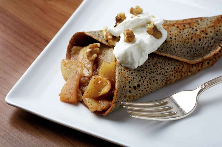 Crepes like the one pictured, filled with walnuts and apples, could be on the menu when The Crepe Addiction opens this summer inside the Fiesta Trails shopping center near the intersection of Interstate 10 and DeZavala Road. Photo: Getty Images / 2017 The Washington Post