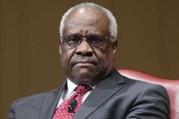 FILE - In this Feb. 15, 2018, file photo, Supreme Court Associate Justice Clarence Thomas sits as he is introduced during an event at the Library of Congress in Washington. Thomas is asking his first questions at Supreme Court arguments in more than three years. Arguments were almost over Wednesday in a case about racial discrimination in the South when the court's only African-American member and lone Southerner piped up.(AP Photo/Pablo Martinez Monsivais, File)