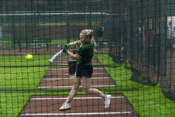 Madie Kilcrease practices batting at the new D-Bat Permian Basin baseball and softball academy is located at 12110 West County Road 100 on Wednesday, Feb. 27, 2019. She played softball at Colorado State before graduating. Jacy Lewis/191 News