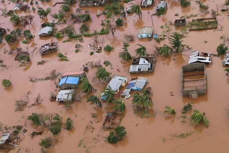 A picture shows houses in a flooded area of Buzi, central Mozambique, on March 20, 2019, after the passage of cyclone Idai. - International aid agencies raced on March 20 to rescue survivors and meet spiralling humanitarian needs in three impoverished countries battered by one of the worst storms to hit southern Africa in decades. Five days after tropical cyclone Idai cut a swathe through Mozambique, Zimbabwe and Malawi, the confirmed death toll stood at more than 300 and hundreds of thousands of lives were at risk, officials said. (Photo by ADRIEN BARBIER / AFP)ADRIEN BARBIER/AFP/Getty Images