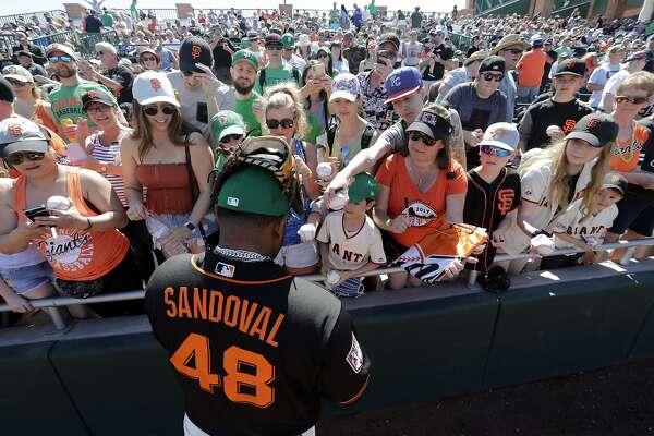 361580eae27 3of8San Francisco Giants  Pablo Sandoval signs autographs before a spring  training baseball game.Photo  Elaine Thompson   Associated Press