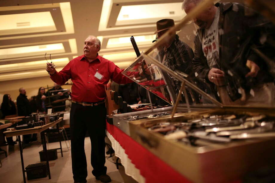 David Petronis at the Saratoga Arms Fair at the City Center in Saratoga Springs, N.Y., Jan. 12, 2013. The overwhelming majority of New York state gun show operators have agreed to new rules to ensure that criminal and mental health background checks are conducted on buyers. (Nathaniel Brooks/The New York Times)