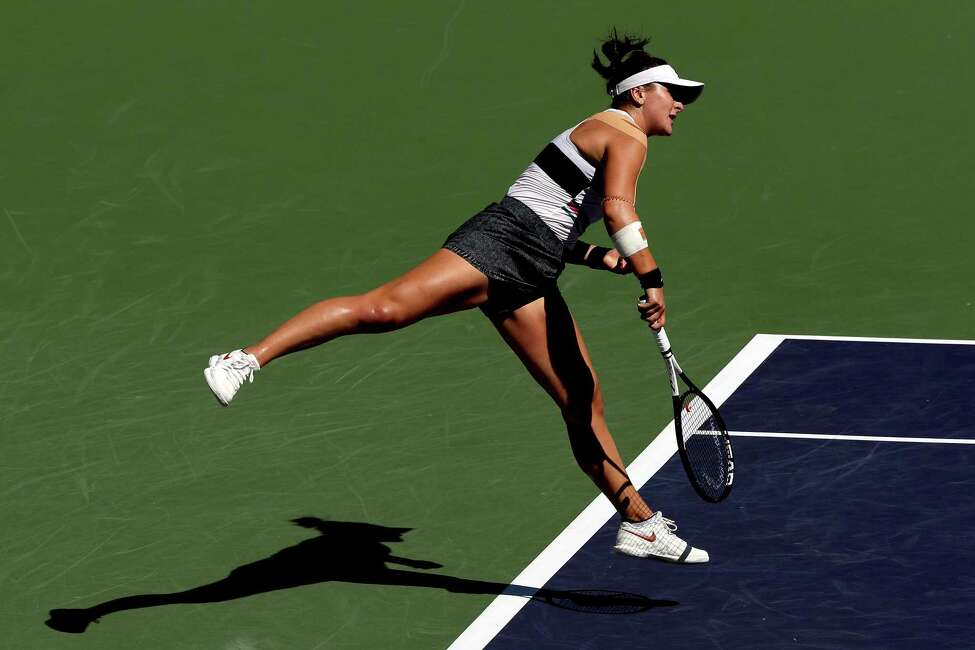 Bianca Andreescu of Canada serves to Angelique Kerber of Germany during the women's final of the BNP Paribas Open at the Indian Wells Tennis Garden on March 17, 2019 in Indian Wells, California.