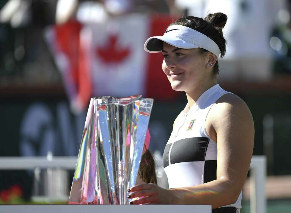 Bianca Andreescu of Canada poses with the championship trophy after her three set victory against Angelique Kerber of Germany in the women's final on day fourteen of the BNP Paribas Open at the Indian Wells Tennis Garden on March 17, 2019 in Indian Wells, California.