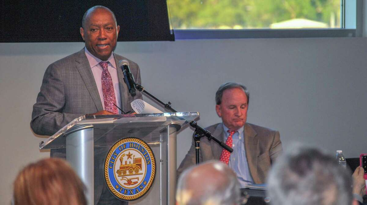 Houston Mayor Sylvester Turner speaks to local residents gathered Tuesday night at a District E town hall meeting. Beside him is District E Councilman Dave Martin.