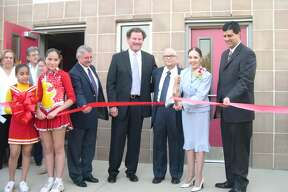 Dr. Joaquin Cigarroa and his wife, Barbara, attend a ribbon-cutting ceremony at LISD. From left are Daniel Garcia, former LISD superintendent, Dr. Dennis Cantu, former LISD school board president, Cigarroa, Barbara Cigarroa and Gerardo Cruz, who at the time was principal of Cigarroa Middle School.