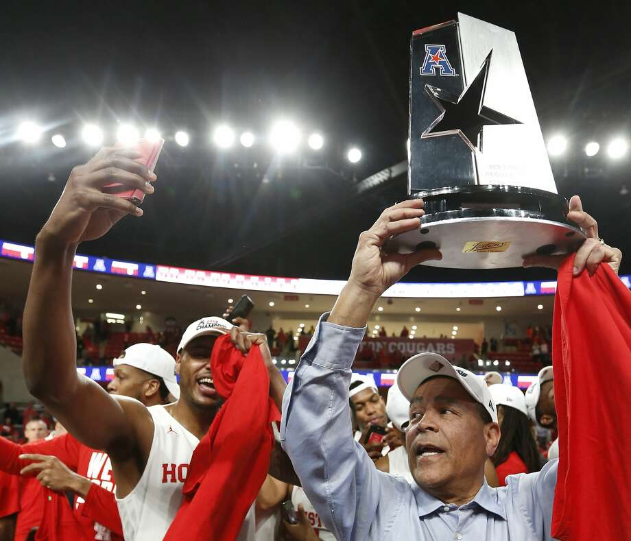 Houston head coach Kelvin Sampson holds up the American Athletic Conference championship trophy as the Cougars celebrate after beating Southern Methodist 90-79 to win at least a share of the AAC at Fertitta Center on Thursday, March 7, 2019, in Houston. Photo: Brett Coomer/Staff Photographer