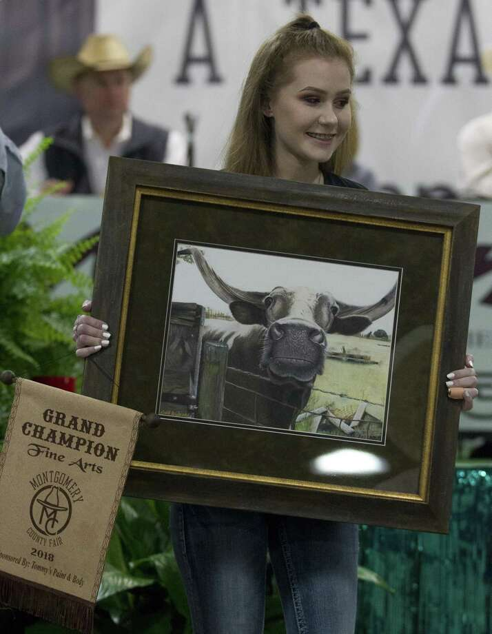 Gabrielle Williams of Magnolia West High School won grand champion in fine art during the junior non-livestock auction at the Montgomery County Fair & Rodeo, Monday, April 16, 2018, in Conroe. More than 1,000 exhibitors showed in one of six divisions. Photo: Jason Fochtman, Staff Photographer / Houston Chronicle / © 2018 Houston Chronicle