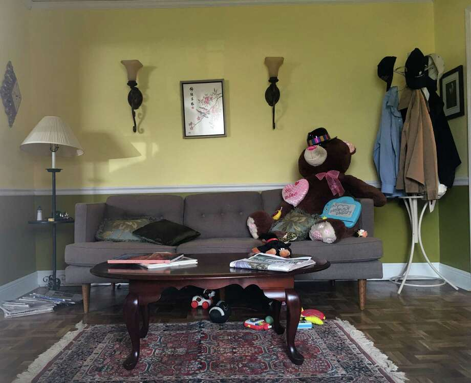 This Aug. 22, 2018, photo shows a room in a New Orleans house, made to look as it might have looked on Aug. 28, 2005, the day before Hurricane Katrina hit New Orleans and levee failures led to catastrophic flooding. Artists have since used theater techniques to make the room look as it might have looked once the flood waters receded almost 14 years ago. The rooms are in a house that sits in front of a floodwall that gave way during Katrina. The exhibit depicting the post-flood rooms will be unveiled on Saturday, March 23, 2019.  (AP Photo/Kevin McGill) Photo: Kevin McGill, STF / Associated Press / Copyright 2019 The Associated Press. All rights reserved.