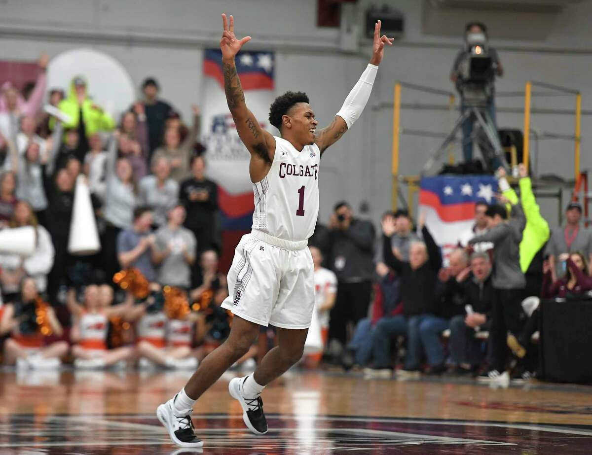 Colgate guard Jordan Burns celebrates a basket during the second half against Bucknell for the championship of the Patriot League men's tournament in Hamilton, N.Y., on March 13, 2019.