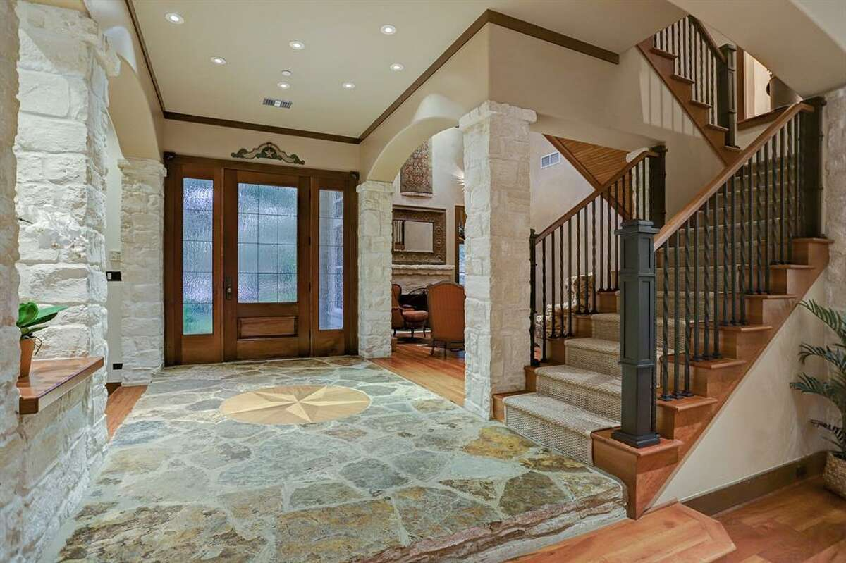Located at 30 Robinlake Lane, this $4.1 million mansion offers a rare lakefront view in the middle of Memorial. Aside from relaxing views of the private, freshwater lake, the6,930 square-foot home boasts five to six bedrooms, four full and three half bathrooms, a game room, a gym, a pool and loggia.