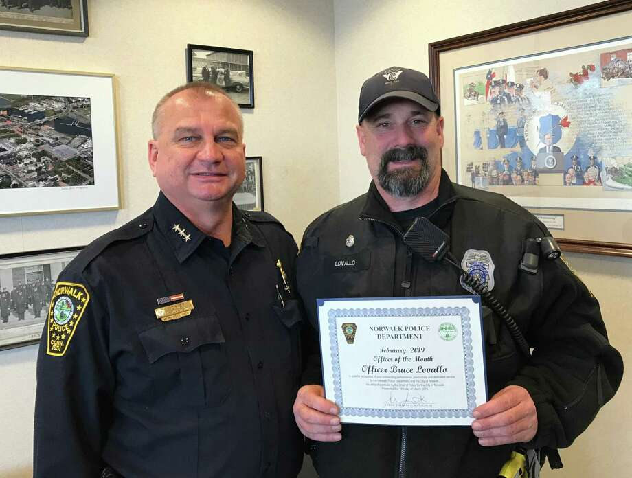 "Officer Bruce Lovallo accepts the ""Officer of the Month"" award from Norwalk Police Chief Thomas Kulhawik. Photo: Contributed Photo"