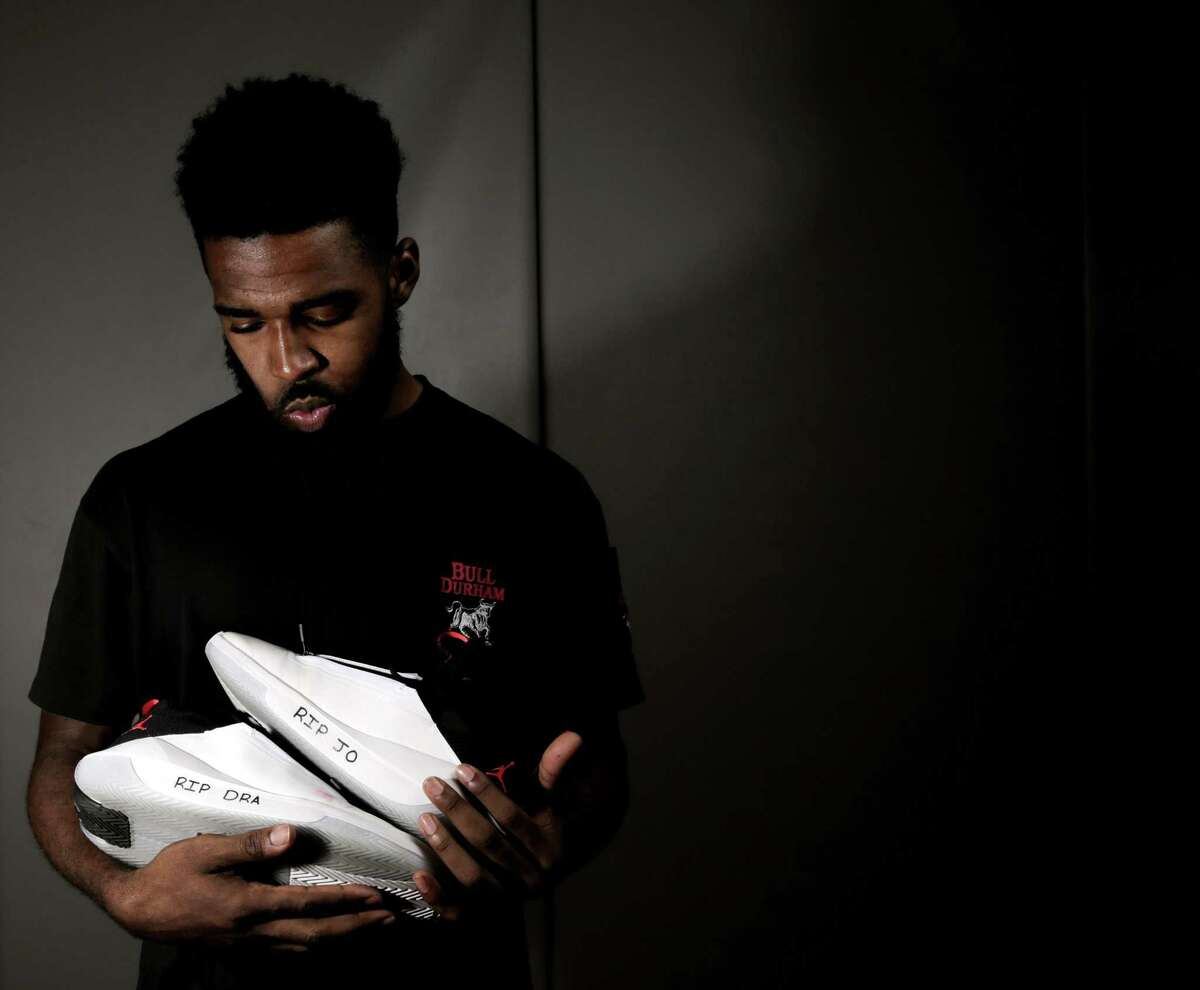 University of Houston senior Corey Davis, writes RIP on his shoes before games to remind himself of friends, family who have passed.