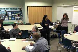 Stratford Town Planner Susmitha Attota, center, speaks to members of the Shakespeare Theater Property Task Force at a meeting March 20, 2019.