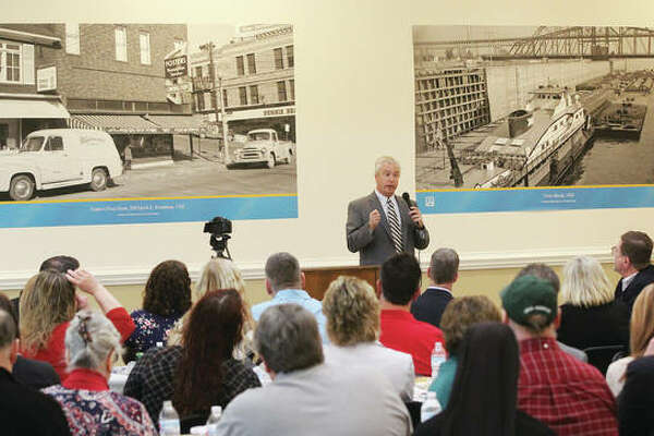 John Mulherin, vice president of government relations for the Hull Property Group, the owner of the Alton Square Mall, talks about plans for the property at an Economic Update lunch by the RiverBend Growth Association. The event, which attracted more than 100 people, was held on the lower level of the mall near the former Macy's entrance.