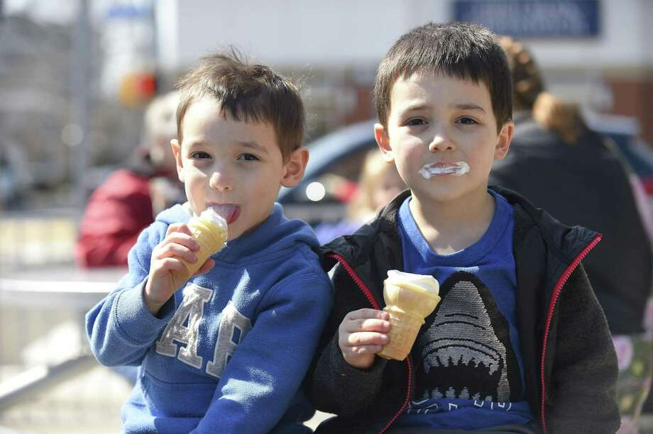 Mark and Charlie Cuesta of Stamford enjoy the first of spring with free ice cream cones from the Dairy Queen in Stamford, Conn. on March 20, 2019. Participating Dairy Queen restaurants hosted Free Cone Day to celebrate the first day of spring today, giving away small vanilla soft-serve cones while supplies last. Photo: Matthew Brown / Hearst Connecticut Media / Stamford Advocate
